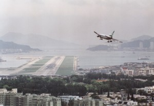 A Cathay Pacific L-1011 Tristar turning finals on runway 13 at Kai Tak (c. 1989)